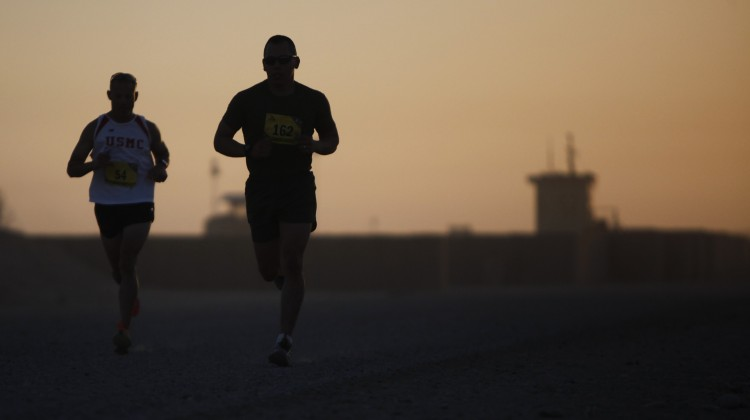Silhouetted Runners. Public domain image
